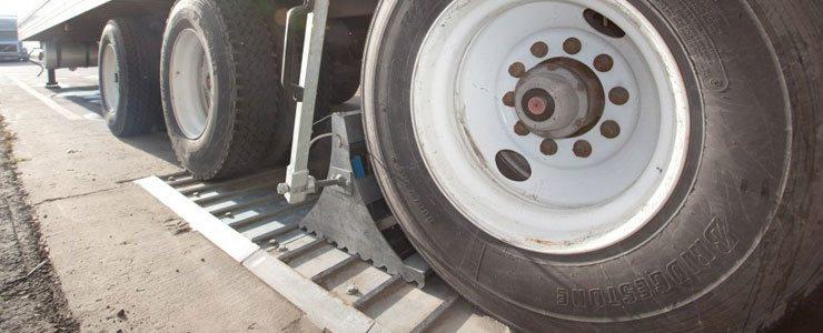 Wheel-based Vehicle Restraint